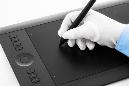 wacom: Varna, Bulgaria - January 10, 2016 Wacom Intuos pro graphic tablet with pen and human hand. Intuos is a product of Wacom a Japanese company specialized in graphics tablets and related products