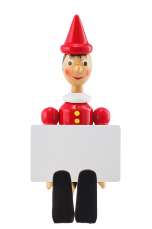 pinocchio: Pinocchio liar toy statue and blank card for text studio isolated on white background