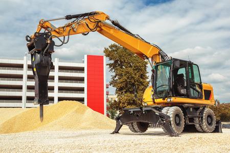 backhoe loader: Backhoe loader or bulldozer - excavator isolated Stock Photo