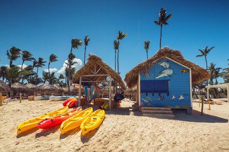 Canoe Kayak boats on sunny tropical beach with palm trees, Punta Cana Editorial