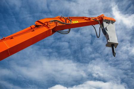 earthmover: Backhoe loader or bulldozer - excavator and blue sky Stock Photo