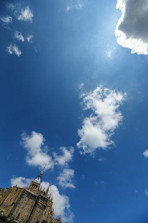 mont saint michel: The fortress Mont Saint Michel against blue sky, France Editorial