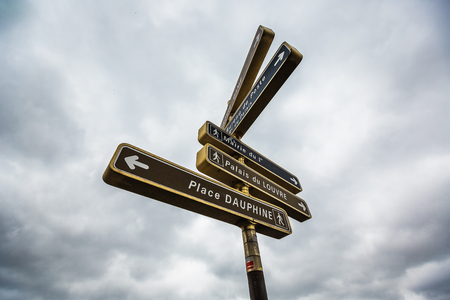 famous places: Tour in Paris, France. Street sign toward the famous places in the city. Stock Photo