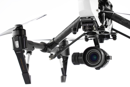 video still: Varna, Bulgaria - April 23 ,2016: Image of DJI Inspire 1 Pro drone UAV quadcopter which shoots 4k video and 16mp still images  and is controlled by wireless remote with a range of 2km, isolated on white Editorial