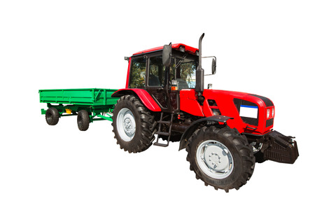 New agricultural tractor and trailer isolated on white background with clipping path Stock Photo