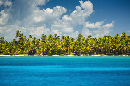 White fluffy clouds blue sky above a surface of the caribbean sea Stock Photo