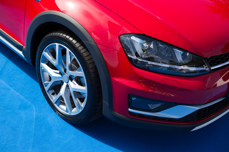 Red car front bumper, light and wheel detail with clipping path