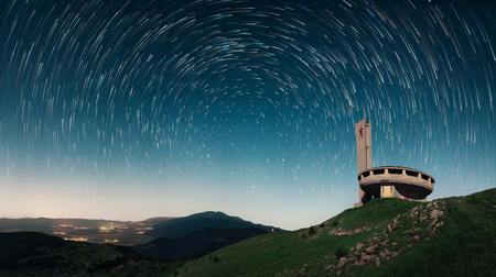 Comunistical monument in Buzludja, Bulgaria.The abandoned monument at night.
