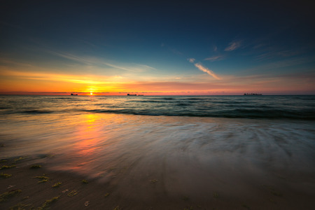 cloudscapes: Beautiful cloudscape over the sea, sunrise shot Stock Photo