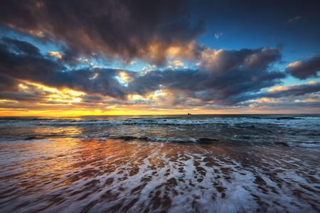 Beautiful cloudscape over the sea, sunrise shot Stock Photo