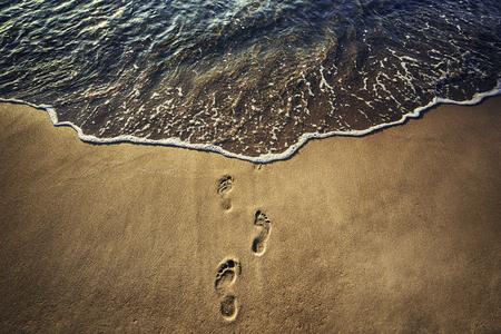 footsteps: Footsteps on the beach,  sunrise shot.