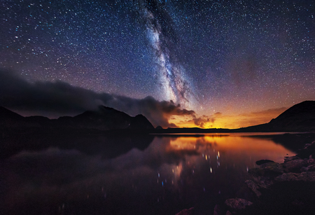 Milky way on over the mountain lake