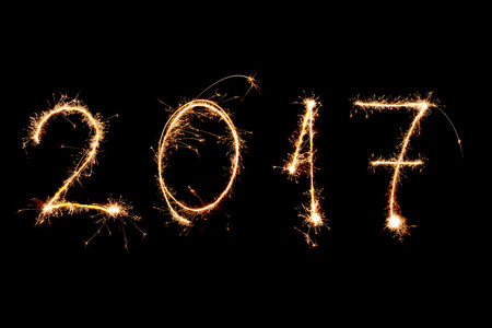 new year's day: HAPPY NEW YEAR 2017 written with fireworks as a background