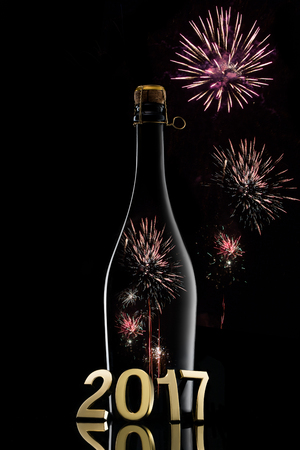 fizz: Champagne wine bottle on black with 2017 concept