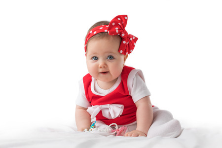 swaddling clothes: Portrait of a smilling baby girl on a white background