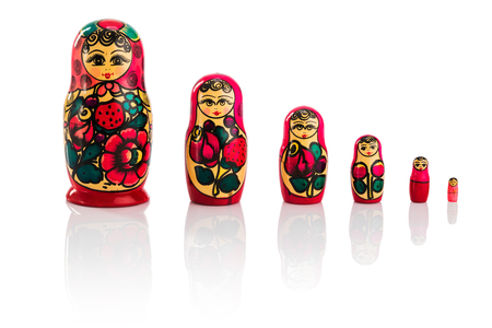 Matrioshka or babushkas dolls on a white background
