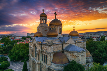 Colorful sunset over The Cathedral of the Assumption in Varna, aerial view