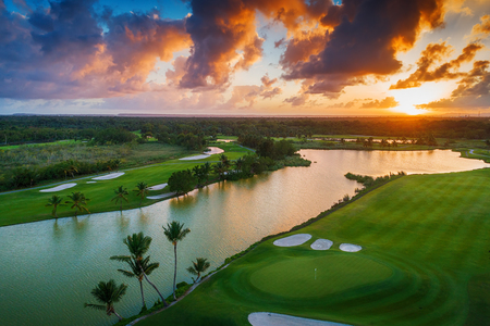 Aerial view of tropical golf course at sunset, Dominican Republic, Punta Cana Stockfoto