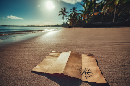 Vintage map and beautiful tropical island, travel concept 写真素材