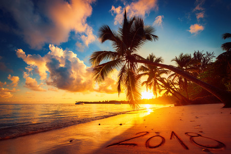 Happy New Year 2018 concept, lettering on the beach. Sea sunrise. Punta Cana Stok Fotoğraf