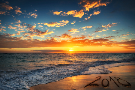 Happy New Year 2018 concept, lettering on the beach. Sunrise over the beach. Punta Cana