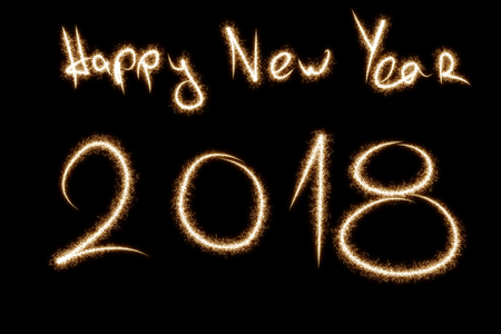 2018 written with Sparkle firework on black background, happy new year 2018 concept.