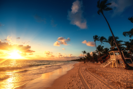 Carribean vacation, beautiful sunrise over tropical beach in Punta Cana