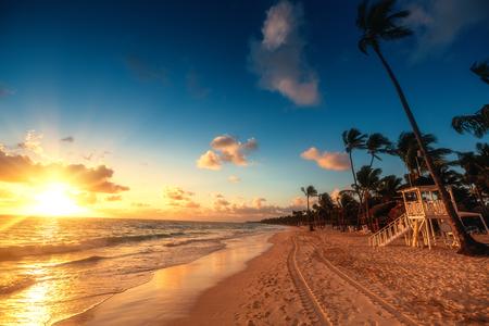 Carribean vacation, beautiful sunrise over tropical beach in Punta Cana