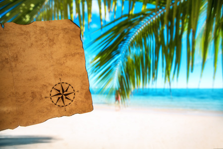 Vintage map and beautiful tropical island, travel concept Stock Photo