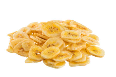 Banana chips on a white background. Stock Photo