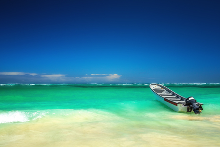 Beautiful carribean sea and boat , panoramic view from the beach
