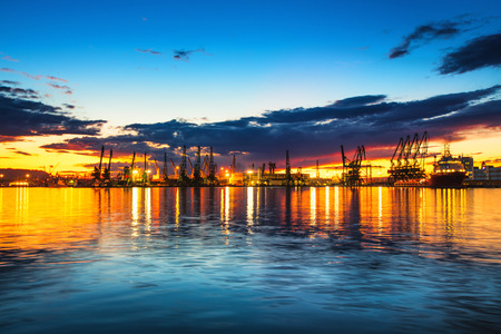 Colorful sunset over sea port and industrial cranes, Varna, Bulgaria Stockfoto