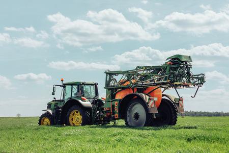 Varna Region, Bulgaria - April 19, 2019: A modern John Deere 6120M tractor on a green field.The 6120M has Premium ComfortView cab.Full Frame design, 2.580 m wheelbase and 4.5 l DieselOnly PowerTech PVX engine 免版税图像