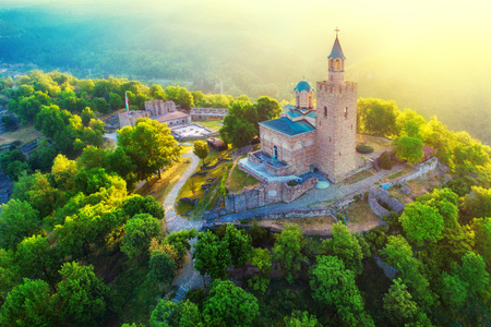 Aerial sunrise view of Tsarevets Fortress in Veliko Tarnovo in a beautiful summer day