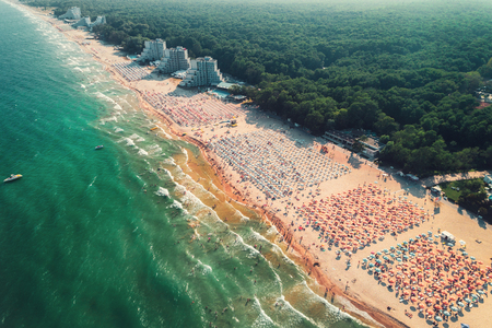 Aerial drone view of Albena sandy beach resort, Bulgaria. Summer tourism. Фото со стока