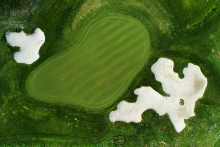 Golf course in luxury resort aerial drone view.