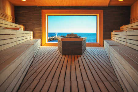 Classic wooden sauna and view toward sea, steam sauna in luxury spa center.