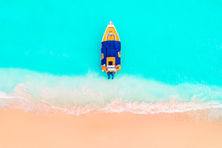 Beautiful caribbean sea and speed boat, panoramic view from the beach