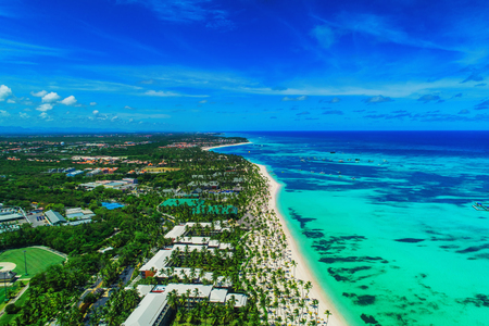 Aerial view of Punta Cana beach resort, Dominican Republic. Summer holiday with parasailing, diving, swimming, sunbathing. Reklamní fotografie