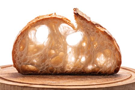 Slice of sourdough freshly baked bread on white background.