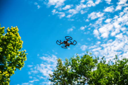 Varna, Bulgaria - July 15 ,2017: Flying drone quadcopter Dji Spark is mini drone that features all of DJIs signature technologies, flying in the sky