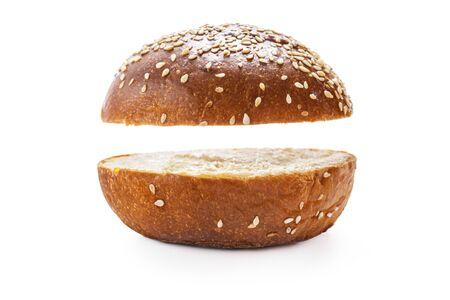 Homemade sourdough bread. Burger bun isolated on white background. Stock Photo