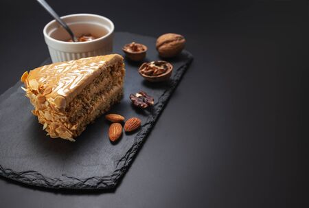 Cake with peanuts, walnuts, chocolate and caramel cream