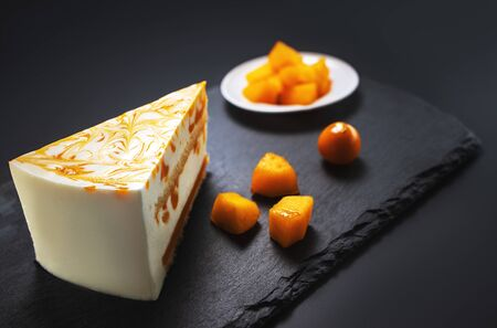 Mousse cake with mango puree and cream.