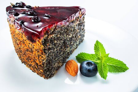 Cake with berry fruits, chia cereals and nuts isolated in white plate