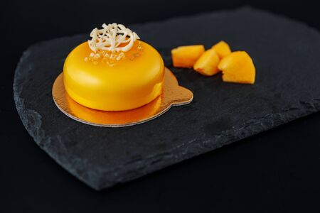 Mousse cake with mango puree and milky cream