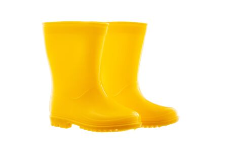 Yellow Rubber Rain Boots for kids isolated on white background