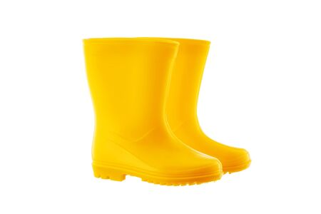 Yellow Rubber Rain Boots for kids isolated on white background.