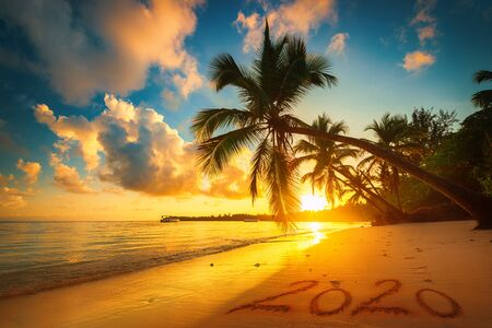 Happy New Year 2020 concept, lettering on the beach. Sea sunrise. Punta Cana