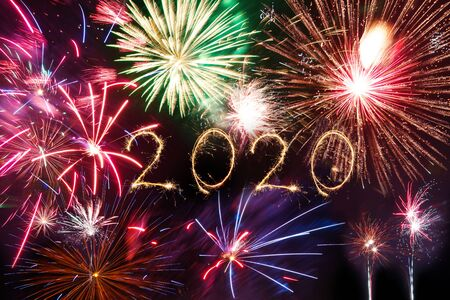 2020 Happy New Year written with Sparkle firework on black background,